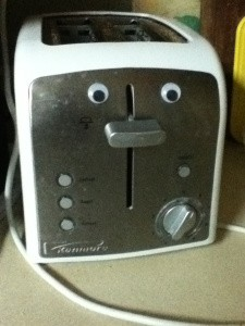 Toaster with googly eyes